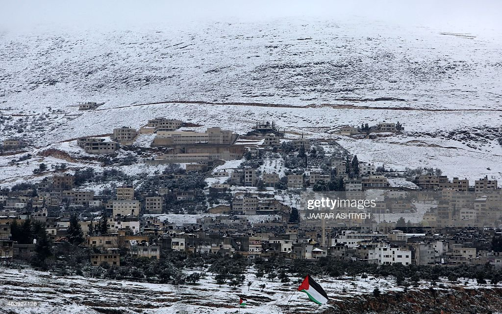 Snow covers the mountain side in the West Bank city of Nablus on February 20 following heavy snow fall AFP PHOTO/JAAFAR ASHTIYEH