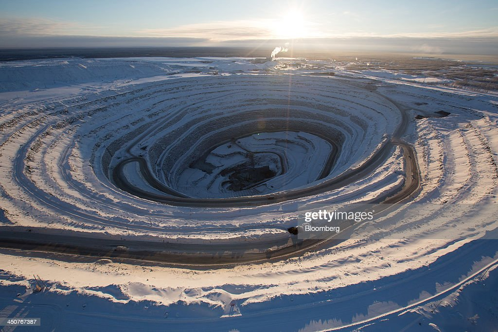 Snow covers the open pit of the Nyurbinsky diamond mine operated by OAO Alrosa in Nakyn, Russia, on Friday, Nov. 15, 2013. OAO Alrosa, the world's largest diamond producer, raised about $1.3 billion in an oversubscribed share sale from investors including Oppenheimer Funds Inc. and Lazard Ltd.'s asset-management unit, First Deputy Prime Minister Igor Shuvalov said. Photographer: Andrey Rudakov/Bloomberg via Getty Images