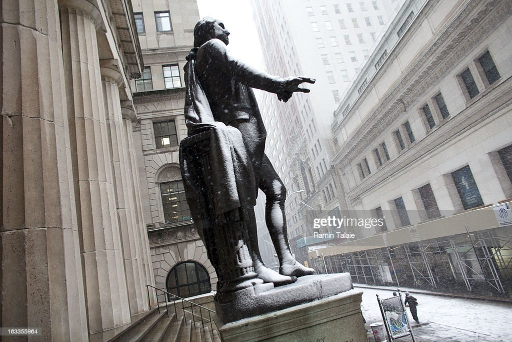 Snow covers the statue of George Washington on Wall Street on March 8, 2012 in New York City. The storm part of the same system that pummeled the Midwest is expected to dump one to two inches of snow in the New York Metro area.