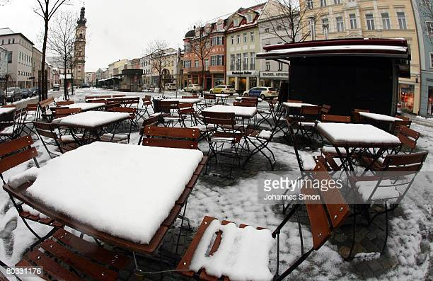 Snow covers the tables and chairs of street cafe at Deggendorf main market place on March 21 2008 in Deggendorf Germany Currently parts of Germany...