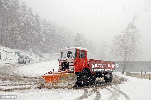 A snow cutter machine clean out a snowcovered Gulmarg Tangmarg road on December 11 2017 about 38 kilometers from Srinagar India