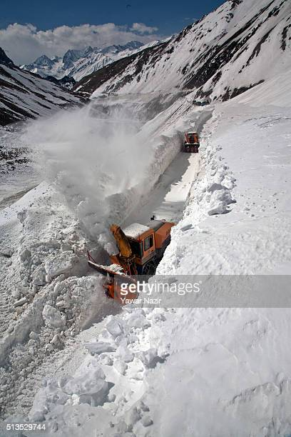 Snow cutters of Indian Border Roads Organisation clearing snow from SrinagarLeh Highway on a treacherous pass which remains snow bound for most of...