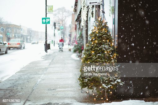 Snow falling on street of Montreal during Christmas time