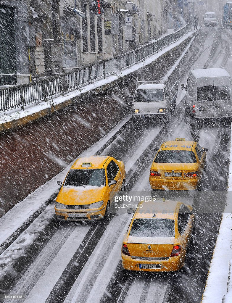 Snow falls during a traffic jam in Istanbul, on January 8, 2013. Heavy snowfall blanketed Turkey's commercial hub Istanbul, a city of 15 million, paralysing daily life, disrupting air traffic and land transport. Officials said the snow is expected to continue until late January 9, according to the weather forecast.