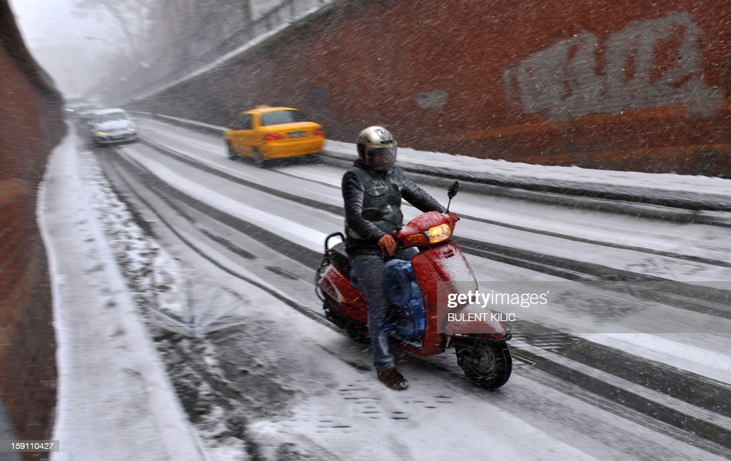 Snow falls during a traffic jam in Istanbul, on January 8, 2013. Heavy snowfall blanketed Turkey's commercial hub Istanbul, a city of 15 million, paralysing daily life, disrupting air traffic and land transport. Officials said the snow is expected to continue until late tomorrow, according to the weather forecast.