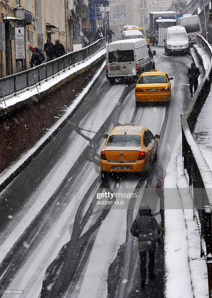 Snow falls during a traffic jam in Istanbul on January 8, 2013. Heavy snowfall blanketed Turkey's commercial hub Istanbul, a city of 15 million, paralysing daily life, disrupting air traffic and land transport. Officials said the snow is expected to continue until late tomorrow, according to the weather forecast.