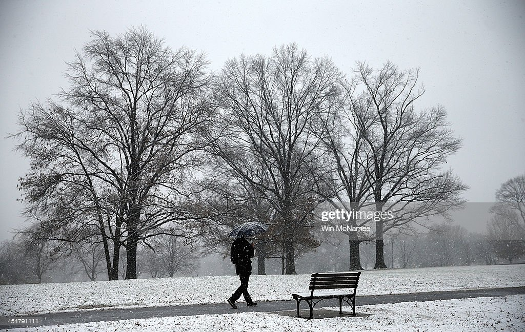 Snow falls during a winter storm at the Marine Corps War Memorial December 10, 2013 in Arlington, Virginia. Forecasts called for significant snowfall in the Washington, DC area as much of the nation reels from severe winter weather.