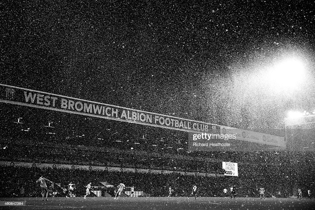Snow falls during the Barclays Premier League match between West Bromwich Albion and Manchester City at The Hawthorns on December 26, 2014 in West Bromwich, England.