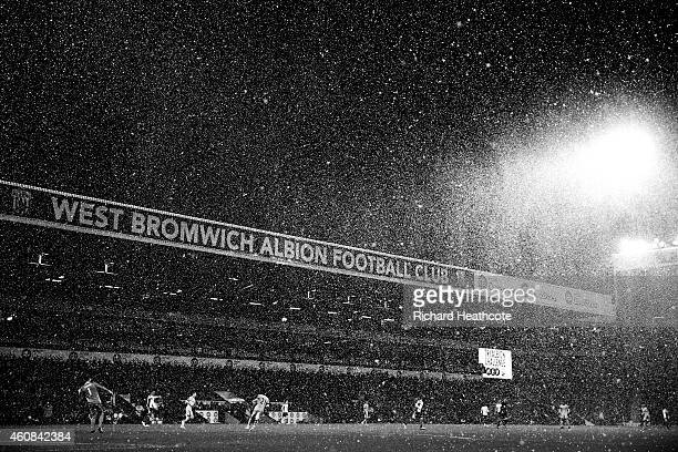 Snow falls during the Barclays Premier League match between West Bromwich Albion and Manchester City at The Hawthorns on December 26 2014 in West...