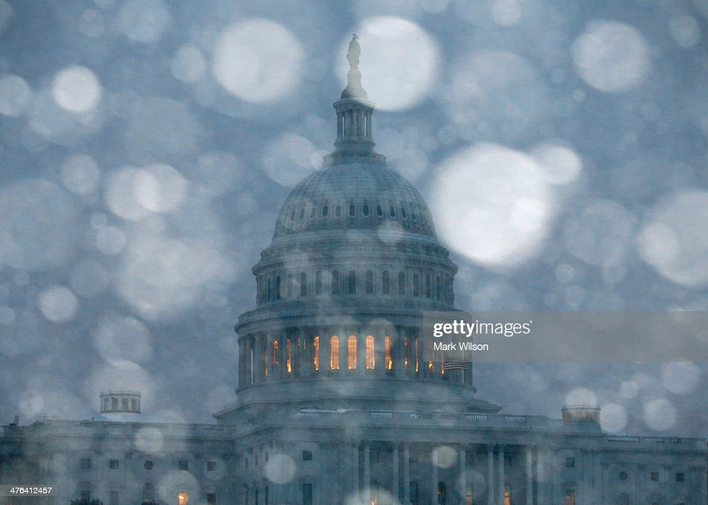 Snow falls in front of the U.S. Capitol on March 3, 2014 in Washington, DC. The Federal Government is closed due to major snow storm that is expected to dump up to a foot of snow in the Washington area.