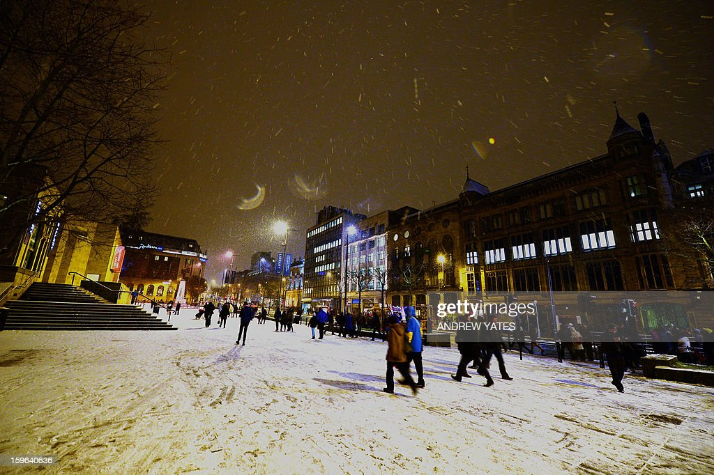 Snow falls in Leeds town centre, northern England, on January 17, 2013.