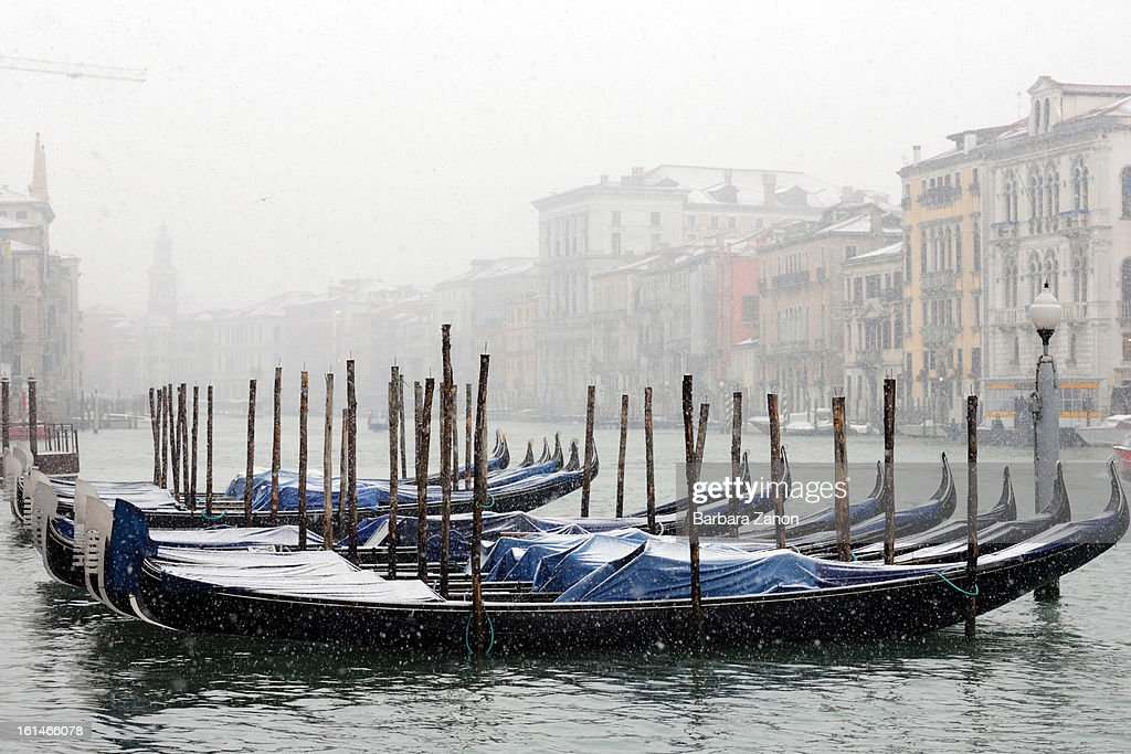 Snow falls near the Grand Canal during heavy snow on February 11, 2013 in Venice, Italy. Heavy snow, rain and wind hit the canals as boats moved commuters across the islands.