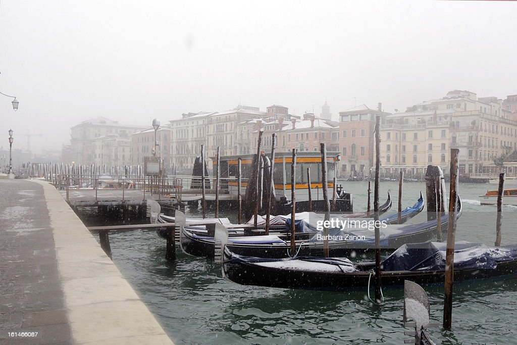 Snow falls near the Grand Canal from Punta della Dogana during heavy snow on February 11, 2013 in Venice, Italy. Heavy snow, rain and wind hit the canals as boats moved commuters across the islands.