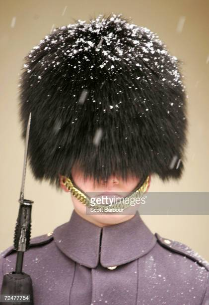 Snow falls on a member of the Queen's Guard outside of St James's Palace on March 4 2005 in London England Schools have been forced to close and...