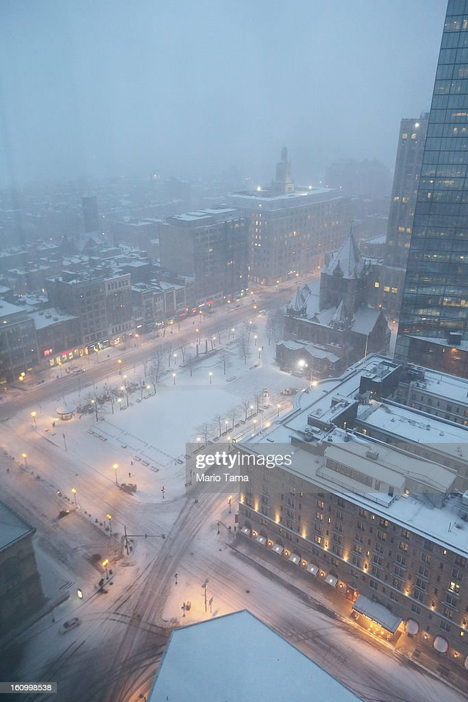 Snow falls on Copley Square at dusk on February 8, 2013 in Boston, Massachusetts. Massachusetts as well as other states from New York to Maine are preparing for a major blizzard with possible record amounts of snowfall in some areas.
