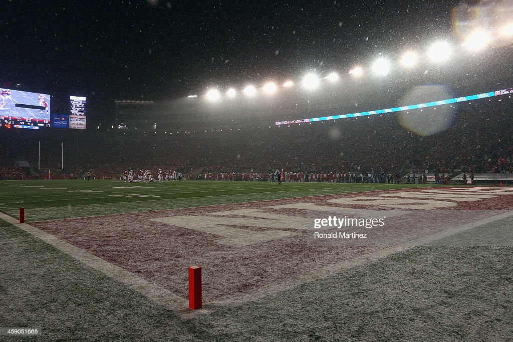 Snow falls on the endzone during play between the Nebraska Cornhuskers and the Wisconsin Badgers at Camp Randall Stadium on November 15 2014 in...