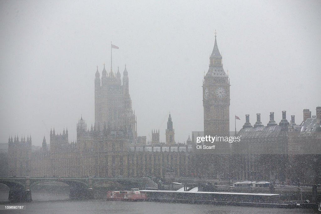 Snow falls on the Houses of Parliament on January 18, 2013 in London, England. Widespread snowfall is affecting most of the UK with school closures and transport disruption. The Met Office has issued a red weather warning for parts of Wales, advising against all non-essential travel as up to 30cm of snow is expected to fall in some areas today..