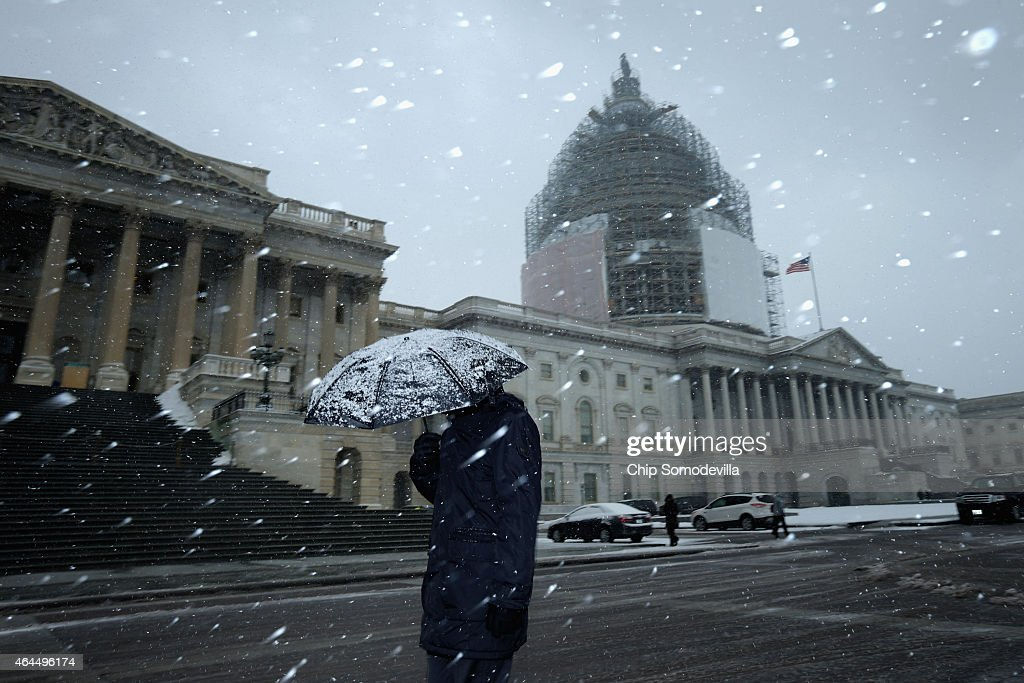Snow falls on the US Capitol as another winters storm covers most of the MidAtlantic and Northeastern States with several inches of frozen...