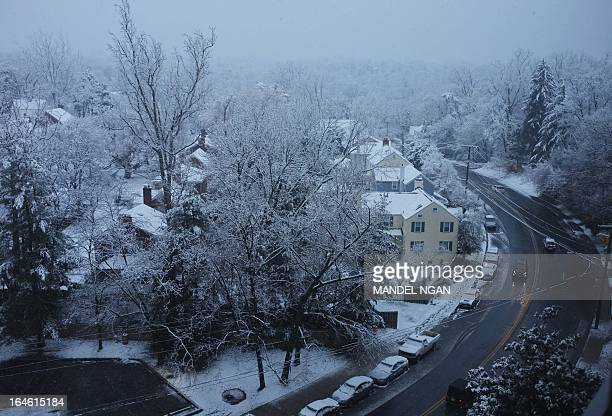 Snow falls over a residential neighbourhood on March 25 2013 in Chevy Chase Maryland A winter weather advisory remains in effect until noon today for...