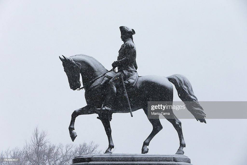 Snow falls past a statue of George Washington in the Public Garden on February 8, 2013 in Boston, Massachusetts. Massachusetts and other states from New York to Maine are preparing for a major blizzard with possible record amounts of snowfall in some areas.