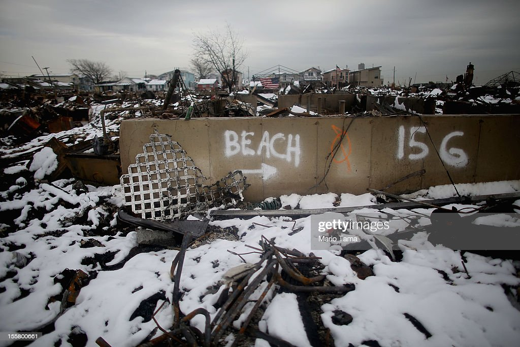 Snow from a Nor'Easter storm coats homes burned in the aftermath of Superstorm Sandy on November 8, 2012 in the Breezy Point neighborhood of the Queens borough of New York City. The storm brought gusting winds, rain, and snow and forced the cancelation of flights for thousands of passengers flying into and out of JFK, LaGuardia and Newark.
