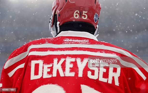 Snow greets the jersey of Danny DeKeyser of the Detroit Red Wings during the first period of the 2014 Bridgestone NHL Winter Classic at Michigan...
