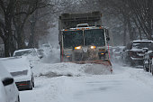 Snow is cleared from a Brooklyn street the morning after a major winter storm on January 27 2015 in New York City Despite dire predictions New York...