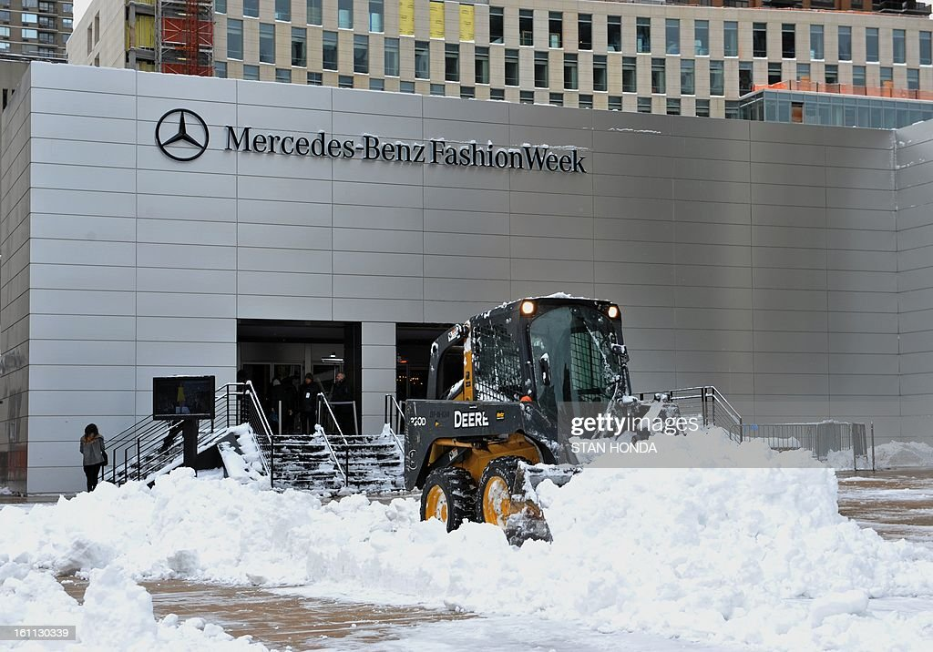 Snow is cleared from the plaza in front of the Mercedes Benz Fashion Week tents on February 9, 2013 at Lincoln Center in New York. AFP PHOTO/Stan HONDA