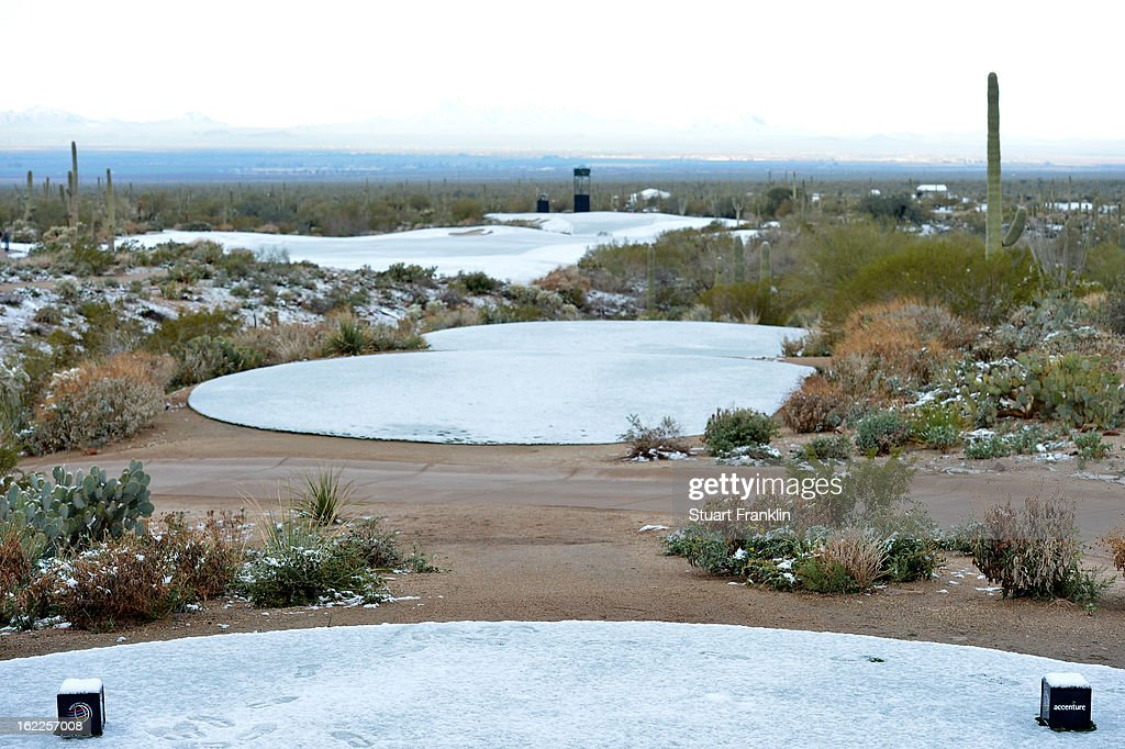 Snow is seen on the course from the first hole tee box as the start of the continuation of round one was delayed due to snow during the World Golf Championships - Accenture Match Play at the Golf Club at Dove Mountain on February 21, 2013 in Marana, Arizona. Round one play was suspended on February 20 due to inclimate weather and is scheduled to be continued today.