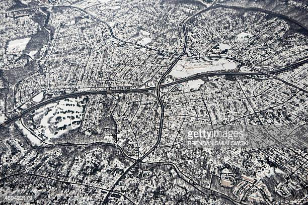 Snow is seen on the ground in northern Virginia from Air Force One as it flies to California February 14 2014 in northern Virginia The snowweary...