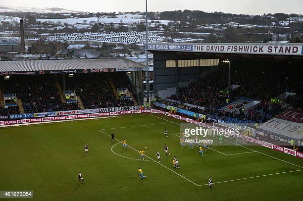 Snow is seen on the hills surrounding Turf Moor as Burnley take on Crystal Palace during the Barclays Premier League match between Burnley and...