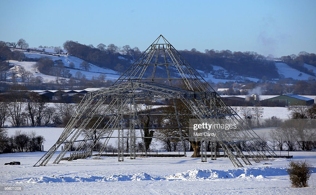 Snow lies on the ground around the skeleton of the main Pyramid stage at the Glastonbury Festival site at Worthy Farm, Pilton on January 7, 2010 in Somerset, England. Extreme weather warnings have been issued across England as heavy snowfall and freezing temperatures have caused further disruption on roads and led to the closure of hundreds of schools and airports. According to the Met Office the latest Arctic cold snap forecast has made this Britain�s coldest winter for 30 years.