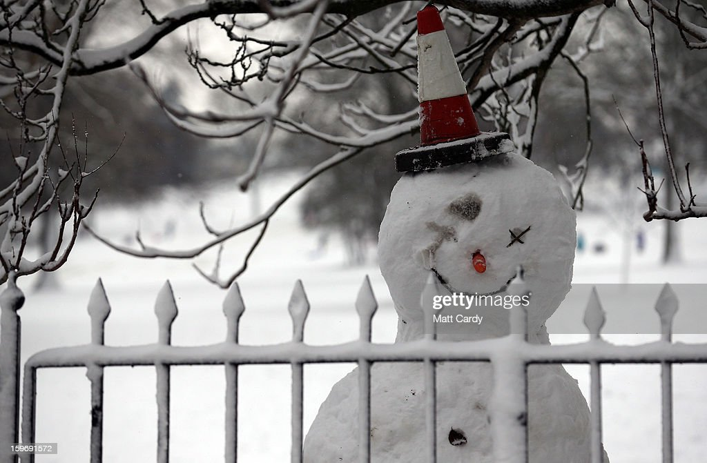 A snow man looks out from the railings surrounding the Bath Approach Golf Course besides Victoria Park on January 18, 2013 in Bath, England. Heavy snow is bringing widespread disruption to many parts of the UK.
