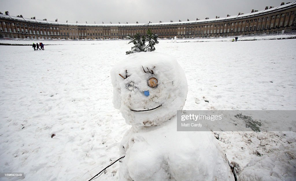 A snow man looks out in front of the Royal Crescent in Victoria Park on January 18, 2013 in Bath, England. Heavy snow is bringing widespread disruption to many parts of the UK.