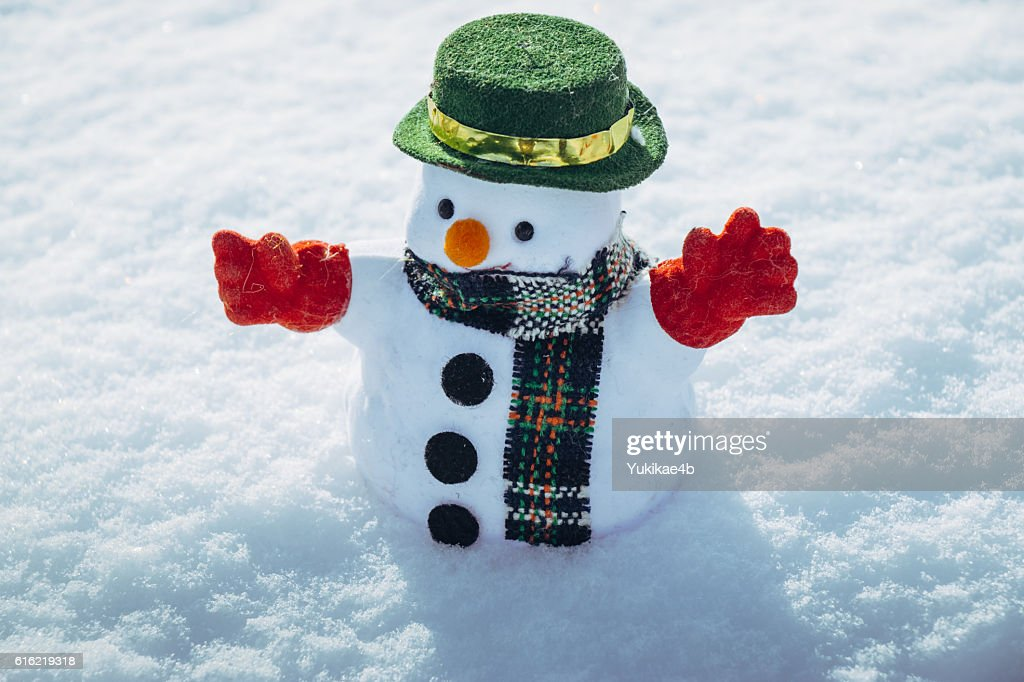 Snow man stand among pile of snow. : Stock Photo