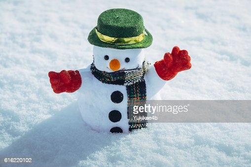 Snow man stand among pile of snow. : Foto stock