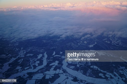 Snow mountains in Hokkaido aerial view from airplane