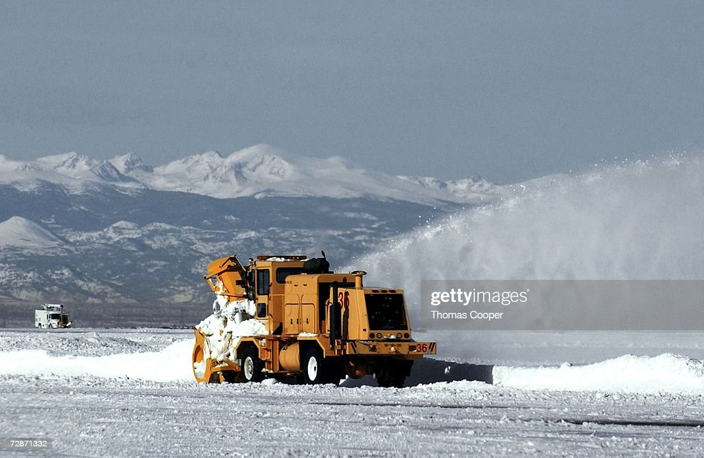Snow movers work to clear the runways at Denver International Airport December 22 2006 in Denver Colorado On Friday the cleanup began a recent...