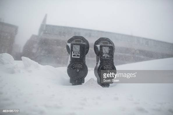 Snow nearly reaches the top of parking meters on Surface Rd during winter storm Neptune which dropped over a foot of snow February 15 2015 in Boston...