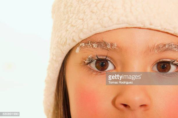Snow on girl's eyebrows and eyelashes