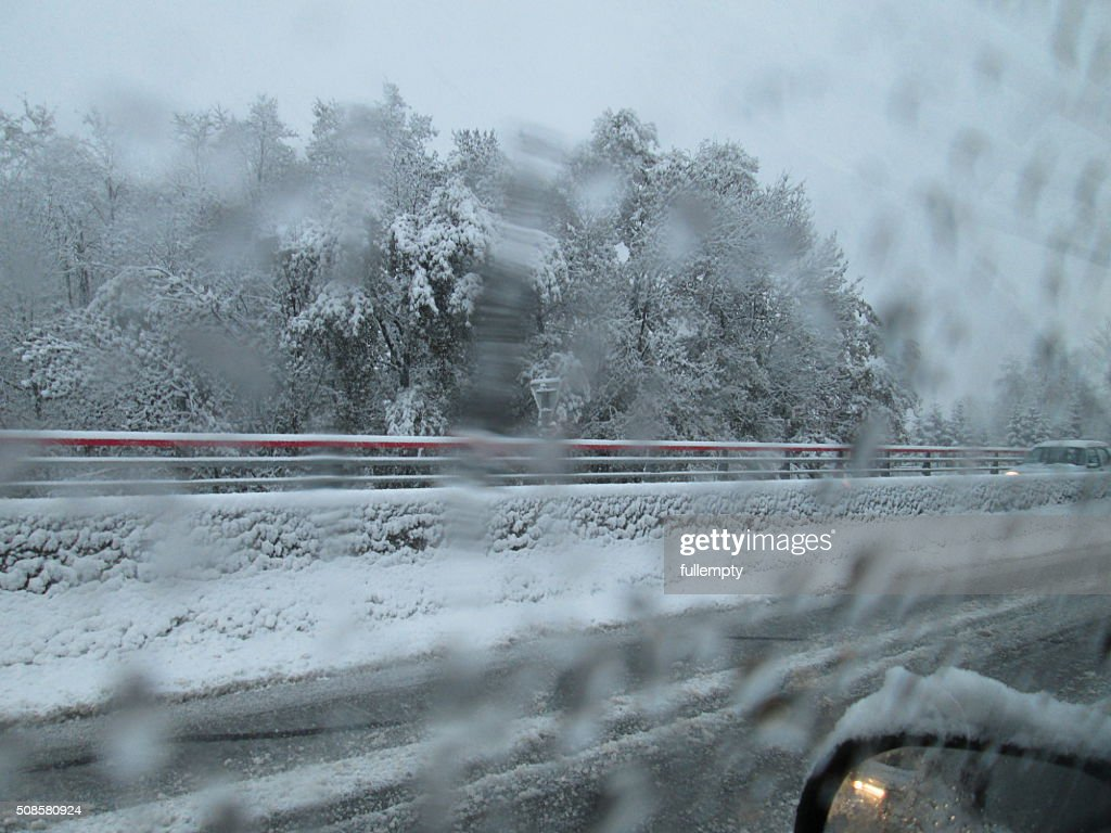 Snow on road from car at night : Stock Photo