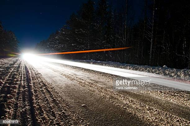 Snow on the road in the woods