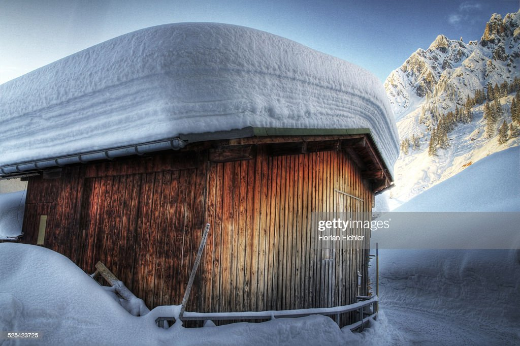 Snow on the roof of a hut