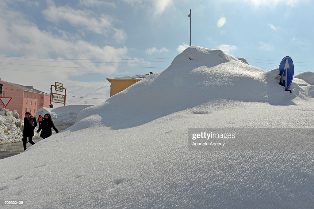 Snow piles are seen on the streets after a heavy snowfall, caused meters of snow depth on the ground in Turkey's Eastern city Bitlis on February 10, 2016. Snowfall covered road, bus stops, traffic signs as well as pavements.