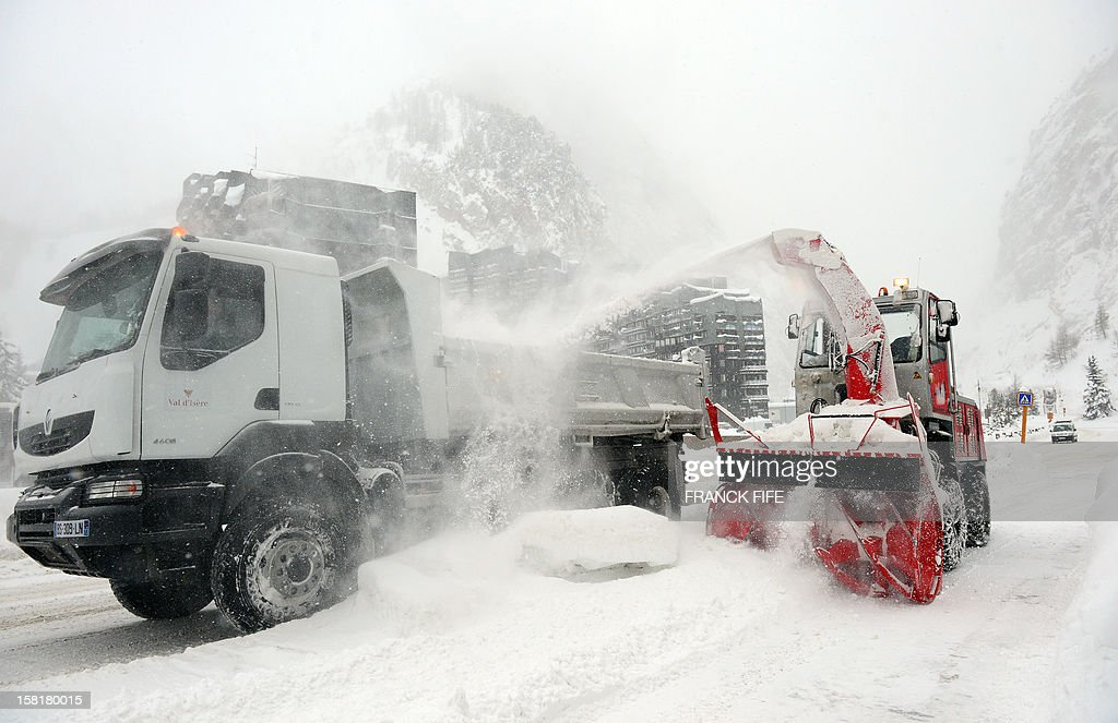 A snow plough clears snow on December 10, 2012 in the French Alps resort of Val d'Isere.