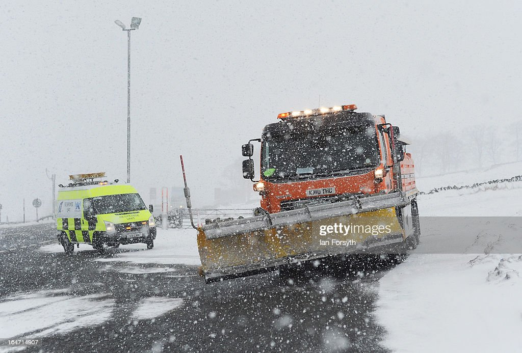 A snow plough clears the A66 road under heavy snowfall near to Bowes in County Durham on March 27, 2013 in northern England. Across the UK heavy snow and freezing temperatures continue to cause disruption as Britain endures the coldest March in 50 years.