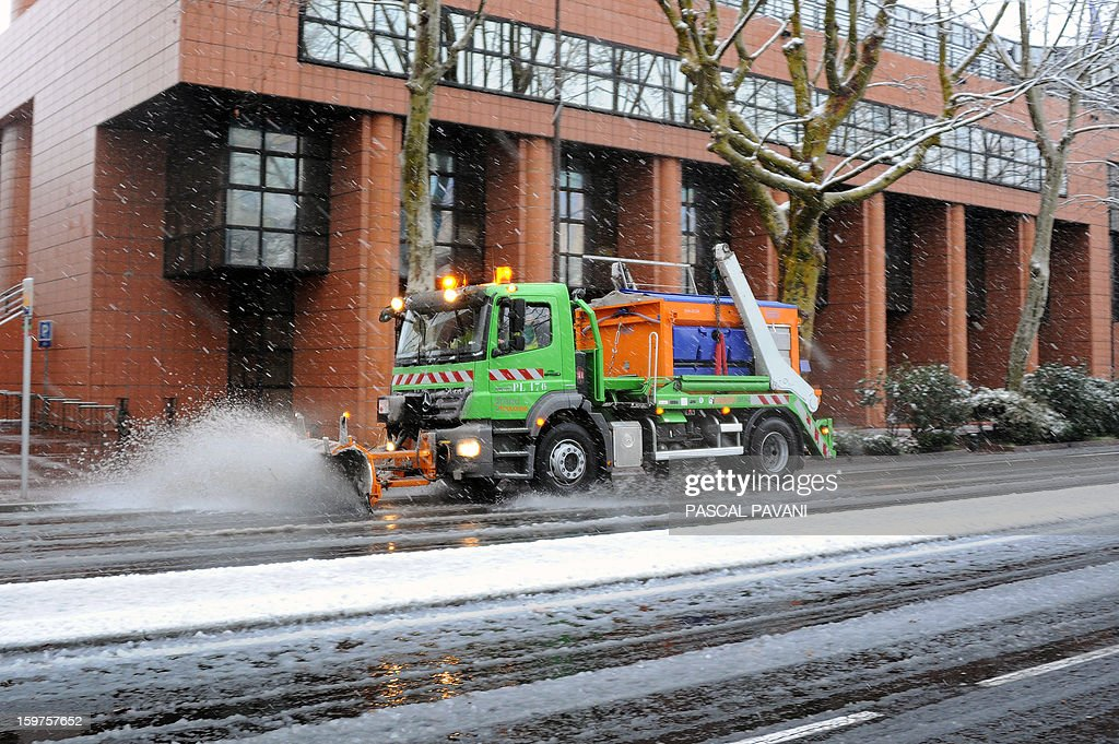 A snow plough clears the snow from a road on January 20, 2013 in Toulouse southern France, after heavy snow falls.