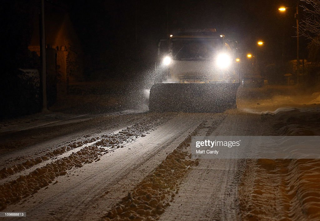 A snow plough drives along the B3139 through Chilcompton on January 22, 2013 in Somerset, England. Fresh snow has brought fresh disruption to parts of the UK.
