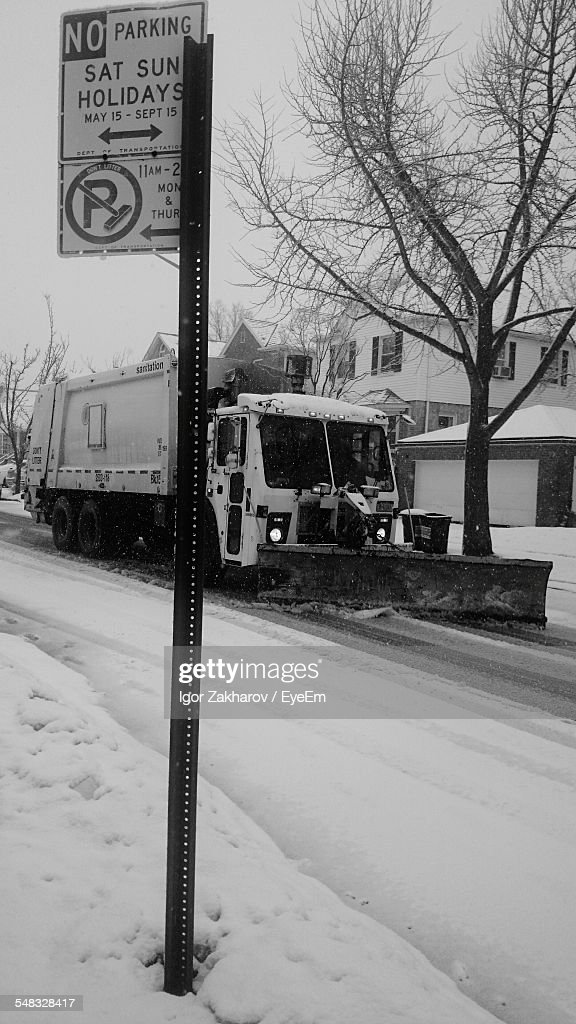 Snow Plow Cleaning Street In City