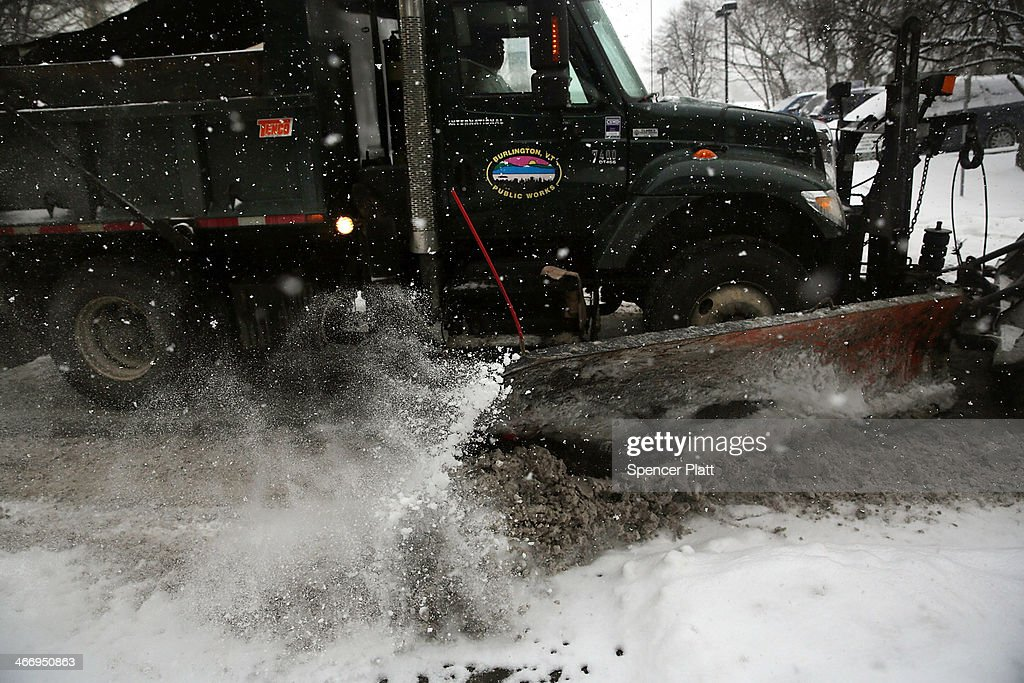 A snow plow clears a street during a snow storm on February 5, 2014 in Burlington, Vermont. Burlington, and much of the Northeast, received another mix of wintery weather on Wednesday causing traffic accidents and hundreds of flight cancelations.
